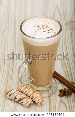 Cappuccino with pastry, cinnamon and flower - stock photo