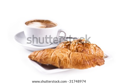 Cappuchino With Croissant isolated in studio. Shallow d o f