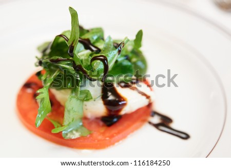Caprese appetizer on plate, close-up - stock photo