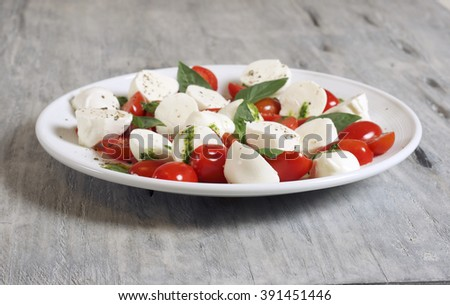 Caprese salad on a white plate