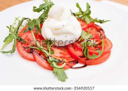 Caprese Salad with Burrata, Tomatoes and Wild Rocket