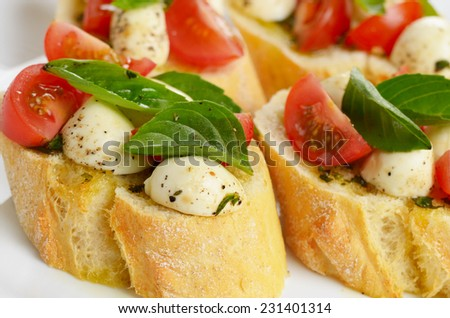 Caprese sandwiches of mozzarella cheese, tomato and basil - stock photo
