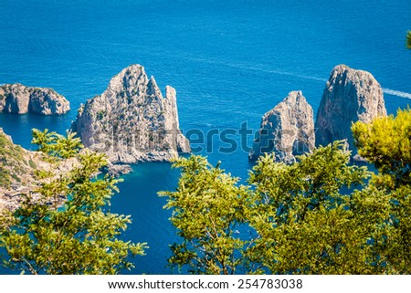 Capri, beautiful and famous island in the Mediterranean Sea Coast, Naples. Italy. Scenics of Faraglioni and seascape from Anacapri, aerial point of view.  - stock photo