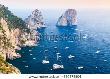 Capri island, Italy. Mediterranean Sea coastal landscape with rocks and yachts - stock photo