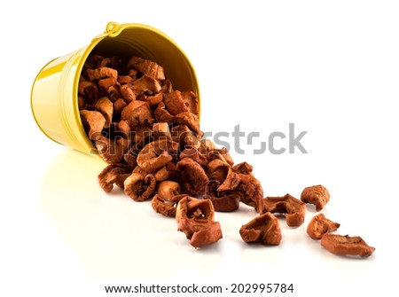 Capsized pail with scattered dried fruits - stock photo