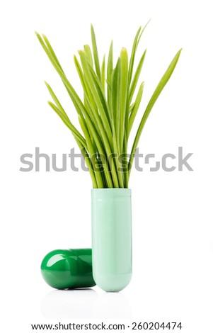 Capsule containing wheat grass - stock photo