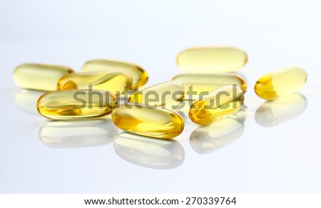 Capsules of fish oil, Omega 3 close-up on gray background.