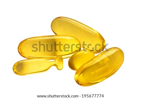 Capsules with fish oil isolated with path on white background. - stock photo