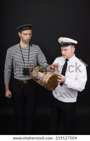 Captain and sailor with the golden cage