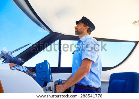 Captain cap sailor boating modern yacht boat indoor with beard - stock photo