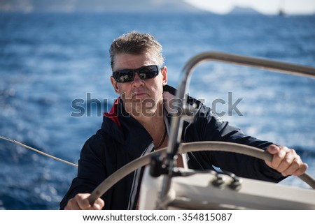 Captain of the yacht, sea, ocean, the wheel
