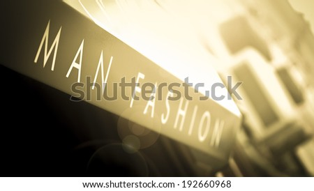 Caption for male boutique (man fashion). Lens Flare and yellow. - stock photo