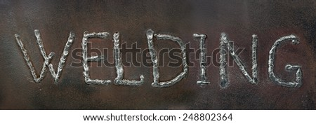 Caption - welding. The word is made by welding in the form of letters. - stock photo