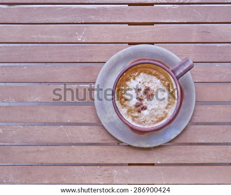 capuccino coffee in brown cup, cinnamon assorted - stock photo