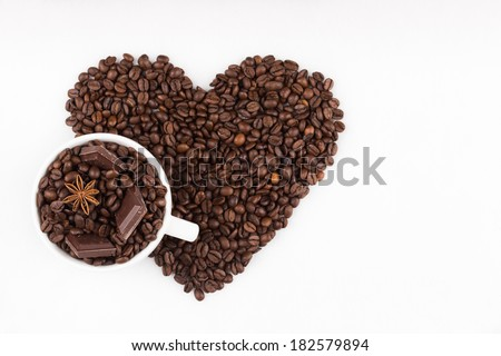 Capuccino cup filled with coffee beans - stock photo