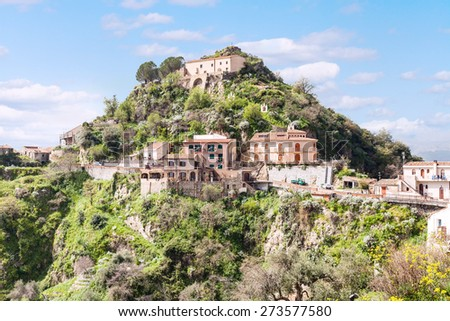 Capuchins Monastery and houses on top of calvario mount in town Savoca in Sicily, Italy - stock photo