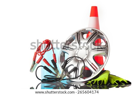 car accesories, alloy wheel,jump start cables,working gloves - stock photo