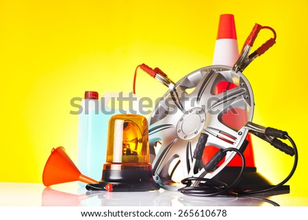 car accessories including alloy wheel and windshield washer fluid - stock photo