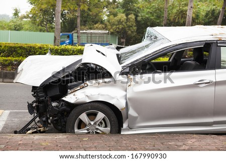 car accident and  wrecked car on the road - stock photo