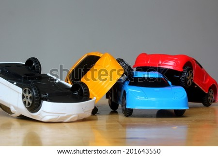 Car Accident concept image with colorful miniature cars. major dangerous bad car crash concept demonstration using small miniature cars - stock photo