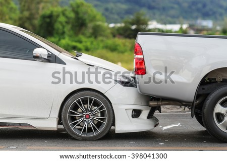Car accident involving two cars on the road - stock photo