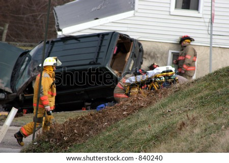 Car accident with firemen. - stock photo