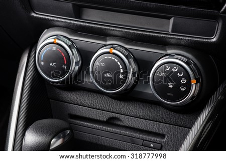 car air conditioner switch, temperature switch - stock photo