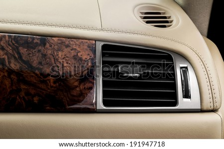 Car airbag panel and air conditioning hole. - stock photo