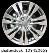 car alloy wheel isolated on black background - stock photo