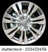 car alloy wheel isolated on black background - stock photo