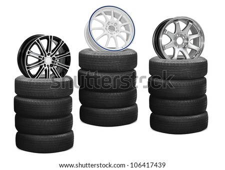 Car alloy wheels on pile tires, isolated on white background (Save Paths for design work)