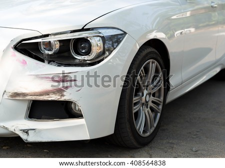 Car an accident with head light damage on the road - stock photo