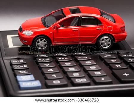car and calculator - stock photo