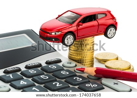car and calculator. rising costs for car purchase, lease, workshop, refueling and insurance - stock photo