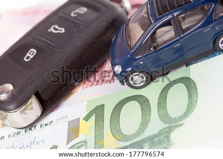 car and Euro banknotes with car key / Car and money - stock photo