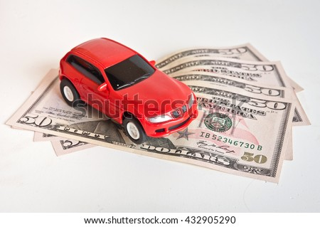 car and money. concept of car loan, Rent, car insurance, buy car Toy car and money over white. - stock photo