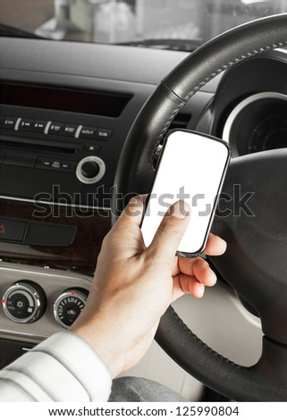 car and road safety concept, businessman text message and driving - stock photo