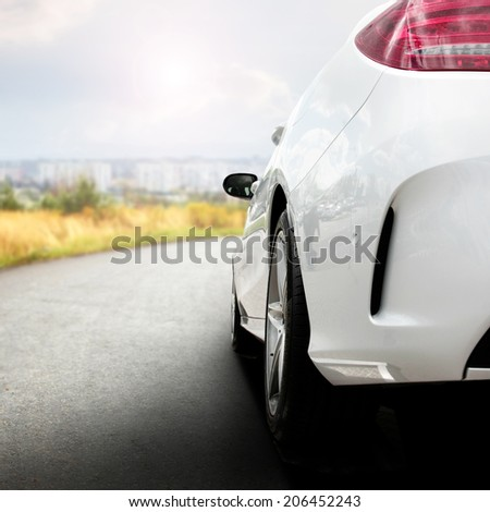 car and street with town landscape