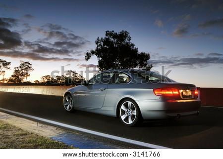 Car at sunset - stock photo