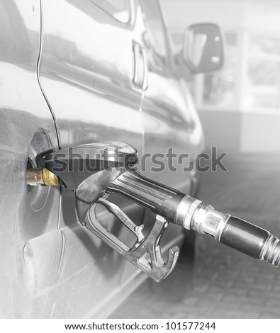 Car at the gas station. - stock photo