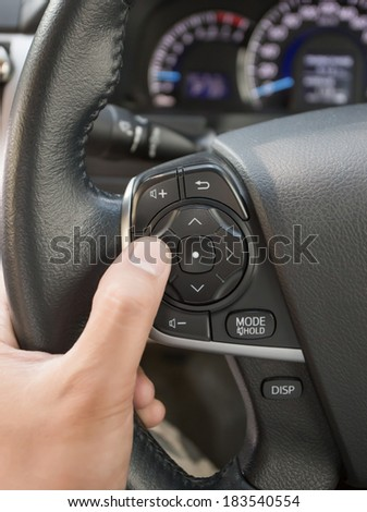 Car audio control buttons on a steering wheel - stock photo