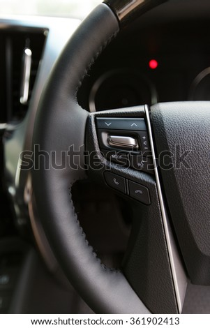 Car audio control buttons on a steering wheel in modern car