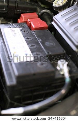 Car battery installed on the car - stock photo
