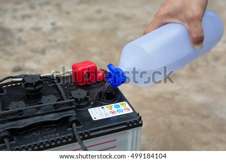 car battery maintenace with distilled water