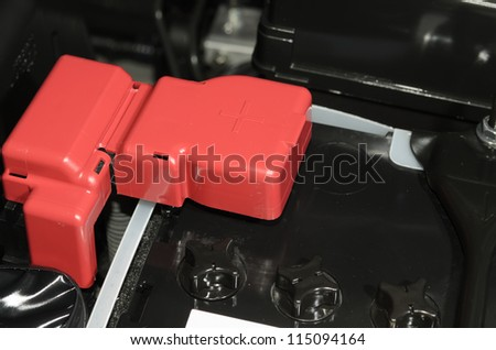 car battery with red positive polarity - stock photo