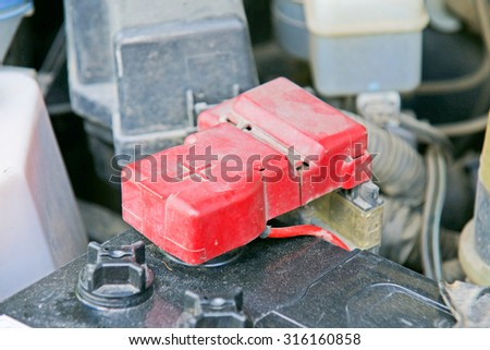 Car battery with red positive polarity for auto concept (Selective focus at positive symbol) - stock photo