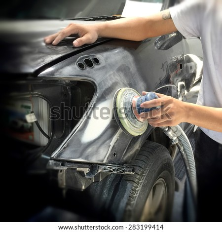 Car body work auto repair paint after the accident. - stock photo
