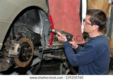 Car body worker. - stock photo