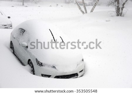 car buried under snow after blizzard in residential area - stock photo