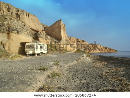 car caravan sea - stock photo